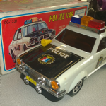 rare Cien Ge 70's Battery Operated highway patrol police car Honda chevrolet ?